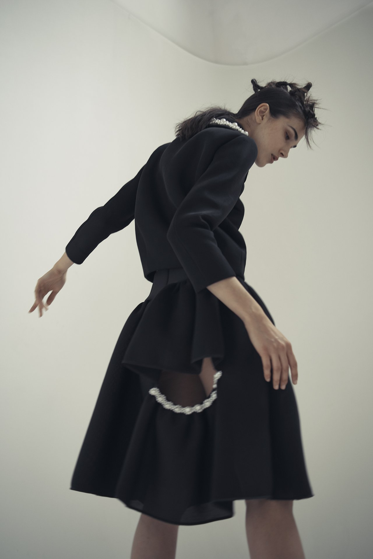 Model Ana Buljevic photographed by Rob Rusling in an ensemble from Simone Rocha's Spring 2014 collection